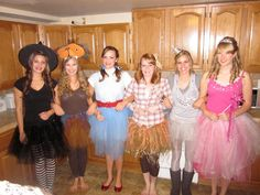 Wizard of Oz costumes with tutus and hats!