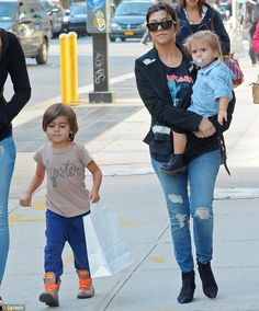 Cool mum: Kourtney Kardashian wore ripped jeans as she took her daughter Penelope Disick, right, and her son Mason Dash Disick, left, out in New York's Soho neighborhood Friday