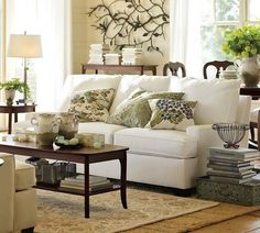 Don't love the white couch, I would probably do it on a dark cream/oatmeal/light beige color. Love the rest of the room, thought!