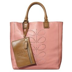 Orla Kiely's Structured Stem Leather Willow Bag in Candy is a smooth leather, unlined bag with punched stem detail to front. Contrast leather handles and detachable flat zip purse. Suede leather on the inside. Inside details include leather patch pocket and key chain.