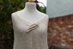 Mulberry silk bride's shawl in crocheted lace, worn with a shawl pin.  Available from http://www.thecrimsonrabbit.co.uk/