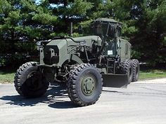 Cat military motor grader with all-wheel drive, joystick controls and crew protection kits. Cat Construction, Heavy Construction Equipment, Heavy Equipment, Army Vehicles, Armored Vehicles, Military Engineering, Caterpillar Equipment, Armored Truck, Heavy Machinery