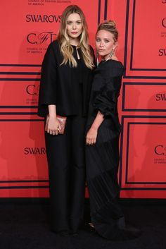 Elizabeth Olsen, in The Row, with Mary-Kate Olsen at the CFDA Awards