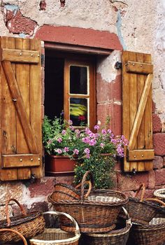 A window and baskets in Collonges-la-Rouge, Limousin, France