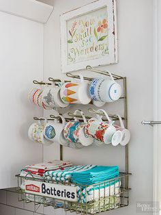 When it comes to storage in the kitchen, think outside the cabinet. A vintage retail display rack is the perfect coffee mug and dish towel holder and adds an interesting focal point to the room.