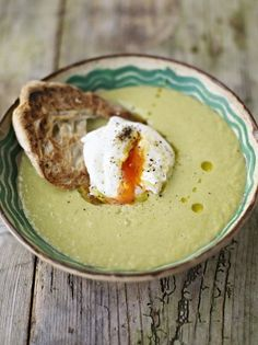 Creamy asparagus soup with a poached egg on toast