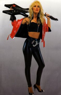 Hot rock guitarist Lita Ford in a revealing black outfit and killer heels. The red jacket matches the lipstick on her full lips and the guitar over her shoulders is a nice touch. Lita Ford, Glam Rock, Glam Metal, Female Guitarist, Female Singers, Rock Style, Punk, Hard Rock, 80s Rock Fashion