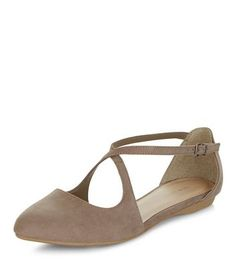 - Soft suedette finish- Cross strap design- Pointed toe