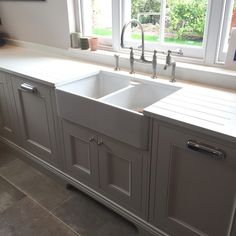 We love working with Aga Rangemaster as their Butler's sink works beautifully with our cabinetry. In this project we included the Ionian tap with pull out from Perrin and Rowe. We can create your project now just click on this picture to begin! #littlegreene #littlegreenepaintcompany #perrinandrowe #aga #agarangemaster #butlerssink #farmhousesink #traditionalkitchen #homedecor #kitcheninspiration #handmadekitchens #handpainted