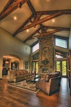 The 20-foot vaulted ceiling in the great room make it truly breathtaking. The space's rustic oak flooring, wall texturing and wooden timbers in the ceiling help give it a cozy Western feel. The real centerpiece of the room is the stone fireplace.