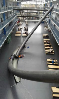 Why take the stairs when you can slide! Technical University of Munich (TUM) built a giant slide from the fourth floor to ground for efficient egress.