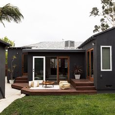 Major #backyard #patio inspiraton from @sarahshermansamuel.  Loving how the white and natural wood accents pop against the charcoal hue. Would you be game to paint your #home a moody color like this?