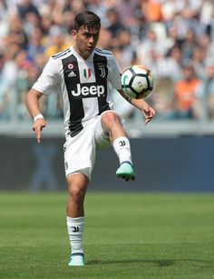 Paulo Dybala of Juventus FC controls the ball during the serie A match between Juventus and Hellas Verona FC at Allianz Stadium on May 19, 2018 in Turin, Italy.
