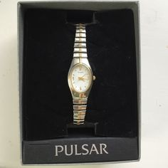 Pulsar watch Silver Pulsar watch (Digital Type series PQ4, PQ2). Gold down the middle of watch with gold numbers. Watch is stretchy, no clasp. Extra links included. Pulsar Accessories Watches