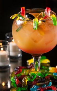 Witches Brew   Ingredients 2.25 oz Caliche Rum  2.25 oz Dark Rum 1.25 oz Bacardi 151  2.5 oz Pineapple Juice  0.75 oz Lime Juice  0.75 oz Simple Syrup  1.25 oz Grenadine  A multitude of Gummy Worms! As many silly straws as desired