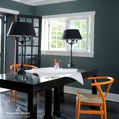 Benjamin Moore Knoxville Gray (HC-160)  Create contrast with traditional yet on-trend grey green. This refined office provides a calming, light-filled space to get down to business. Playful orange Wegner Wishbone chairs pop against walls painted in Benjamin Moore's Knoxville Gray (HC-160). #paint