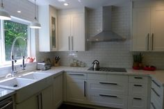 We don't think we're exaggerating when we say you'll never believe what this kitchen looked like before! A 1950s kitchen got an extreme makeover with white ÄDEL doors, stainless steel appliances, and a HJUVIK faucet all from IKEA.