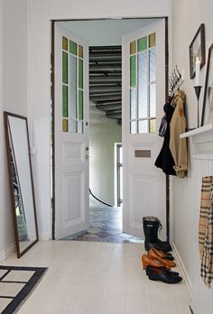 Family style with colored glass doors, shiny white floors, coat rack