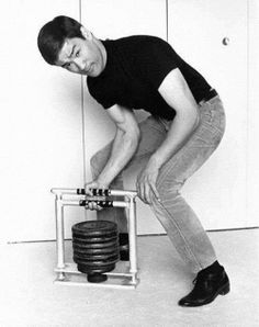 Bruce Lee working on grip strength with weights