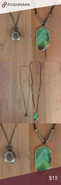 Amazing long necklace bundle First necklace is on long dark bronze chain with matching locket on the end with a crest design - it does not open (it looks like it opens but after many attempts, no luck). The second necklace has a beautiful green flat stone on a long brown leather strand, with two sets of gold medal detail/beads. Please ask if you have any questions.  These necklaces have been worn a few times but are in like new condition. Great statement pieces! Jewelry Necklaces