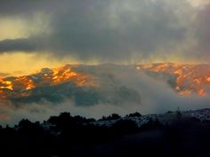 Another from the train, watching the sun come up over the snow covered mountains.