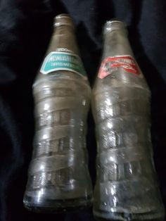 McMahons Rope/Spiral design bottles with green and red pyro labels (damaged). Ipswich Queensland.