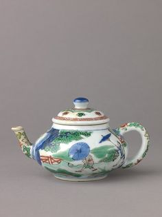 Small covered wine pot or teapot Artist: Chinese , Qing Dynasty, Kangxi period Date: 1662–1722 Culture: Chinese Medium: Porcelain painted in underglaze blue and overglaze famille verte enamels.