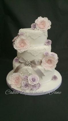 Pale pink peonies, lavender roses  and white hand scrolled lace ~ wedding cake