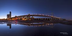 https://flic.kr/p/eQDEcM   Bay Bridge Water Reflection   Bay Bridge Water Reflection panoramic view at Pier 32. This location is no long open to the pubic since they start the construction for the Warriors new stadium. The other thing is the water reflection that have to wait till next year for the raining season. It wasn't that easy to take the wide angle panoramic shot during the twilight long exposure. It was a totally lucky snapshot IMHO;)   Nodal Ninja
