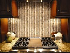Alpine Series from Puccini on the backsplash. A mix of stone and glass. Love it.