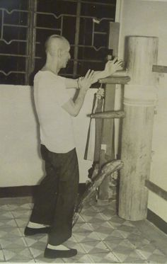 Wing Chun Grandmaster Ip Man practicing on a wooden dummy in 1967.5