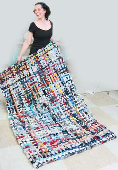 Love this idea! wonder if i have enough old clothes to make this. DIY Potholder Rugs It would make a great kids room or family room rug!!!