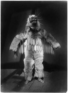 Hamasilahl--Qagyuhl Creator(s): Curtis, Edward S., 1868-1952, photographer  c1914 November 13.  Ceremonial dancer, full-length portrait, standing, wearing mask and a fur garments during the Winter Dance ceremony.