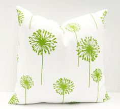 white pillow with lime green flower print, pantone greenery, lime green, spring green, apple green, bright green