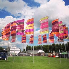 We are Liz Cooke and Joe Truman and we have been making and installing flags at festivals since transforming landscapes with our colourful designs. Peace Flag, Wayfinding Signs, Colourful Designs, Horseshoe Art, Prayer Flags, Durga Puja, Isle Of Wight, Site Design, Banner Design