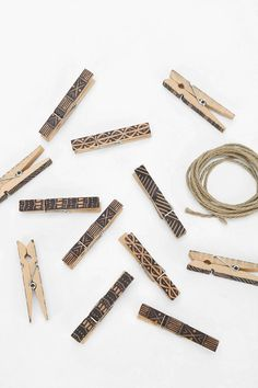 for decorating/hanging photographs with a little flair! clothespins - wires - black sharpie pen or paint... have some fun and hang some memories!