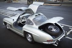 This 1955 Mercedes-Benz 300 SL Alloy Gullwing surfaced for sale but was never used in a race, It has plaid interior. This car sold for $4.62 million (including commission) on Jan 21, 2012. It is thought to be a world record for this model. :O