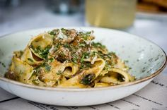 House-made tagliatelle, crushed pine nuts and walnuts, grated Parmesan, basil pesto.