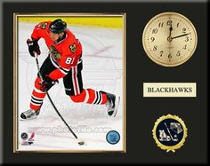 One 8 x 10 inch Chicago Blackhawks photo of Marian Hossa inserted in a gold slide-in frame and mounted on a 12 x 15 inch solid black finish plaque.  Also features a 3-inch Arabian gold-faced clock, a customizable nameplate* and a 2-inch hockey medallion with a gold base. $59.99 @ ArtandMore.com