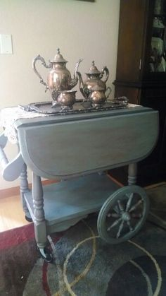 Tea cart from the same Ethan Allen collection as the dry sink/changing table.  Repainted and still in my dining room.