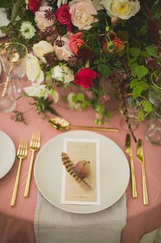 Wild at Heart -- fig and feather table setting for a wedding, gold silverware