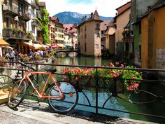 Annecy, France I will be going here one day..And I want to ride a bike over their. Here I come France.