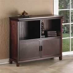 Free Shipping! Luxurious and uncomplicated, this richly colored espresso storage cabinet features cubby storage and cabinet storage all in one piece of contemporary designed furniture. Internally, the cabinet has two shelves for storing magazines, DVD's, or books.