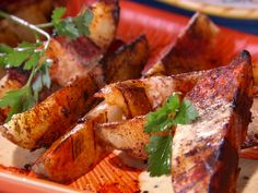 Grilled Potato Wedges with Smoked Paprika Mayonnaise Dressing recipe from Bobby Flay via Food Network