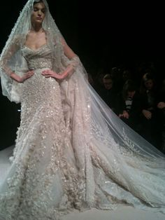 Elie Saab- I'm not a fan of beadwork on wedding dresses. That being said, I would wear this.