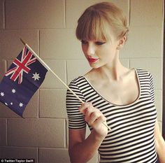 Fun in the land Down Under: Taylor posted a snap on her Twitter page of her holding a mini Australian flag, and told her fans she is 'loving' her stint in the country