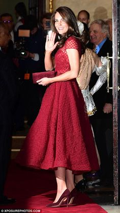 Kate gives wellwishers a final wave before heading inside...