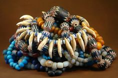 Collection of antique African Trade beads and a lion tooth and glass bead necklace, collected in DR Congo