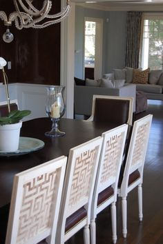 beautiful greek key detail on the dining room chairs--interesting contrast between front and back of chair