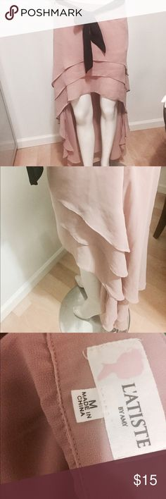 Stunning pink skirt with black tie Beautiful layered pink skirt by L'atiste by Amy. Has a black tie. Very flowy fabric. Latiste by Amy Skirts